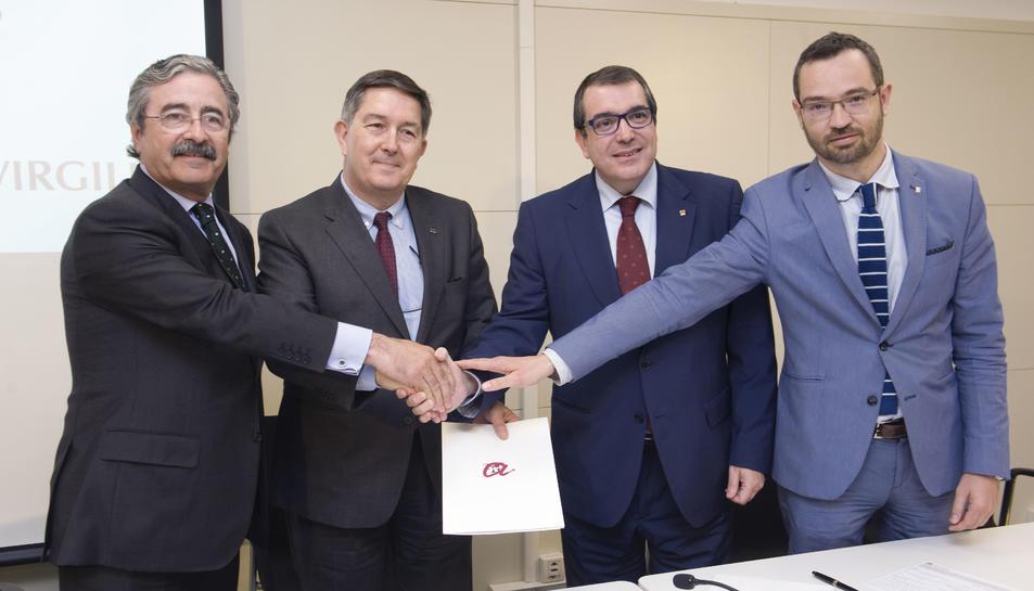 KimFaura, Josep Anton Ferré, Jordi Jané i Frederic Adan, ahir a la tarda en la signatura del conveni.