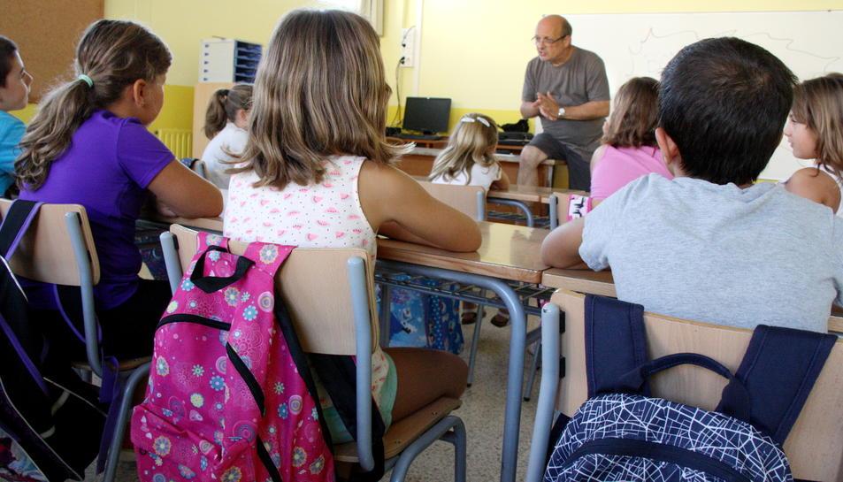 Imatge d'arxiu d'alumnes en una classe.