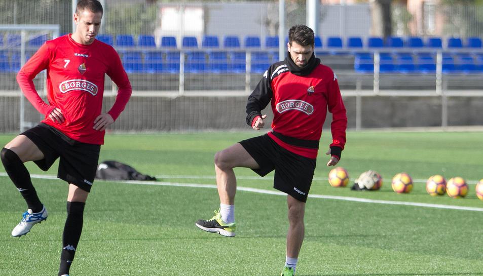 El portuguès Vítor Silva, a la dreta, amb el davanter David Querol, en la tornada als entrenaments després de les vacances de Nadal.