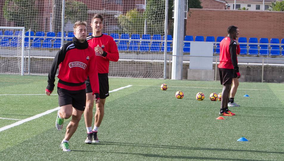 Jesús Olmo i Joan Campins, durant un dels entrenaments del conjunt roig-i-negre, fa algunes setmanes, al municipal de Riudoms.