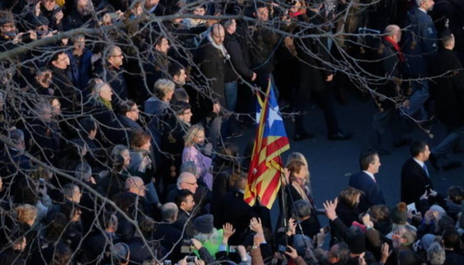 Mas, Ortega i Rigau, durant el recorregut pels carrers de Barcelona camí del TSJC. Imatge del 6 de febrer del 2017.