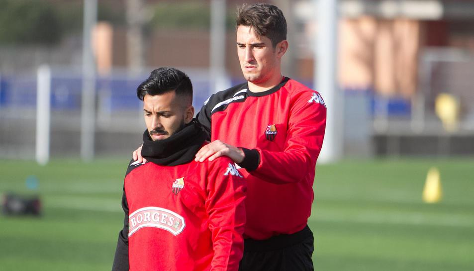 L'atacant Jorge Díaz i el defensa Joan Campins, en una de les sessions de preparació.