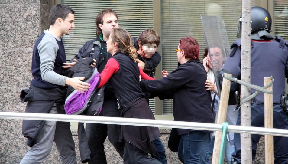 Els aldarulls i càrregues policials a Tarragona durant la jornada de vaga general del 14 de novembre del 2012 van acabar amb un menor ferit per un cop de porra.