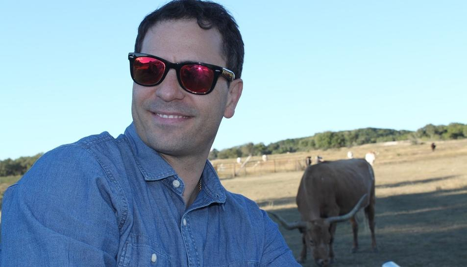 Víctor amb els Long Horns, la raça bobina pròpia de Texas.