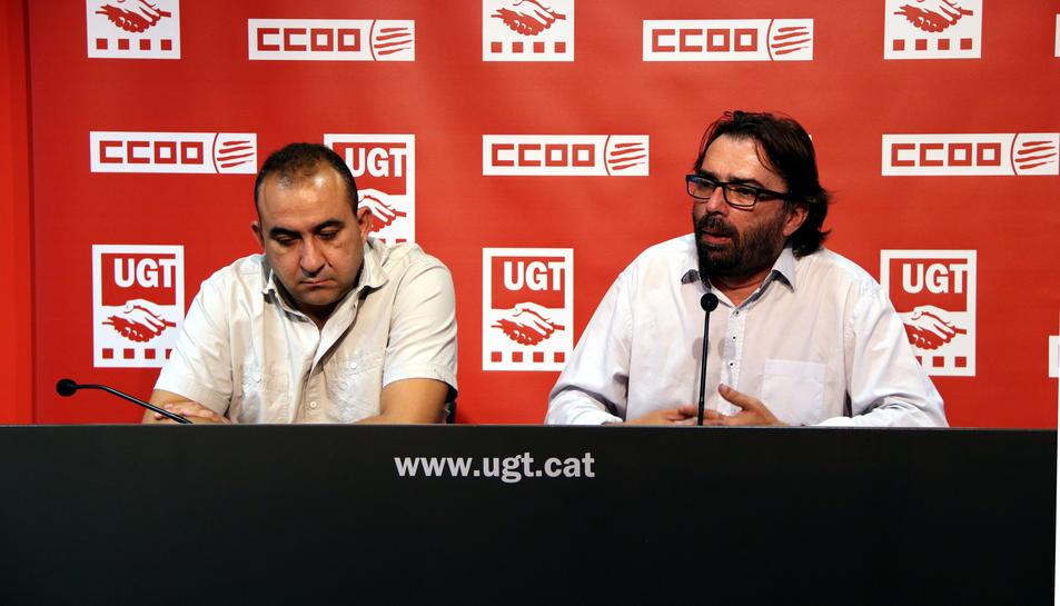 Els secretaris generals d'UGT i CCOO, Camil Ros i Javier Pacheco, en roda de premsa a la seu d'UGT.
