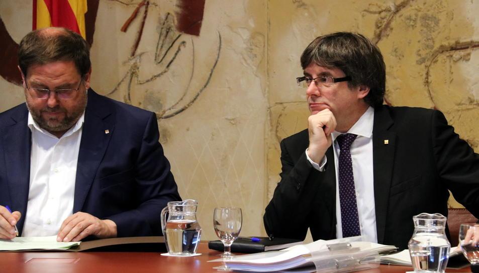 El vicepresident del Govern, Oriol Junqueras, i el president de la Generalitat, Carles Puigdemont.
