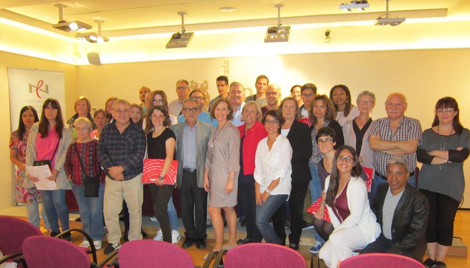Imatge dels participants durant la presentació de la 33a edició del programa Voluntariat per la llengua de Reus.