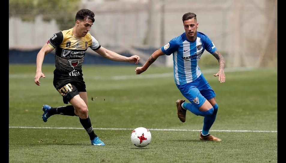 El futbolista andalús, a la dreta de la imatge, amb la samarreta de l'Atlético Malagueño, filial del Málaga.