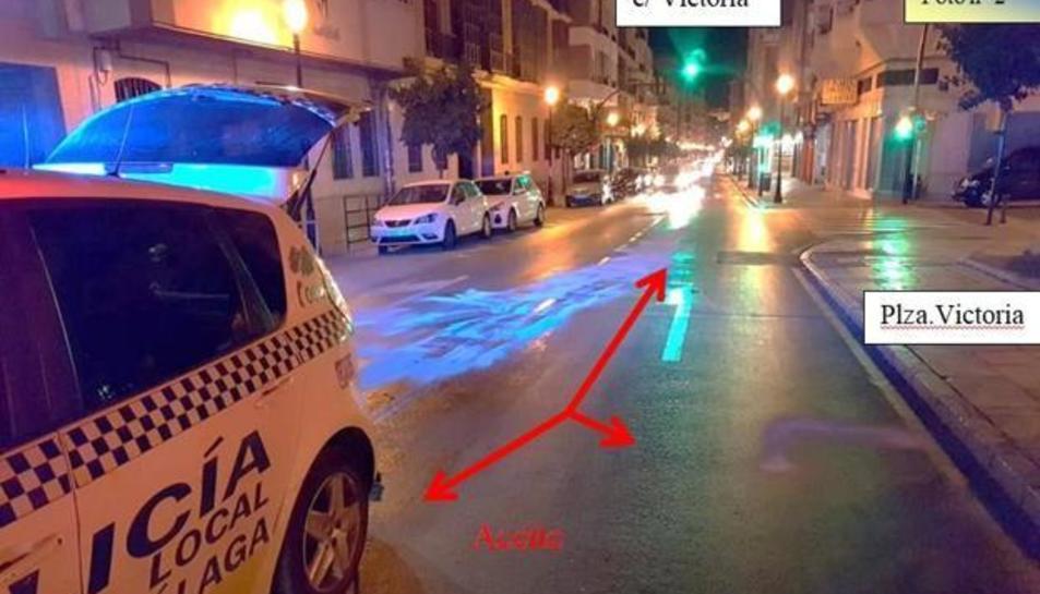 Imatge de la policia local de Màlaga on s'assenyala la presència d'oli a la calçada.