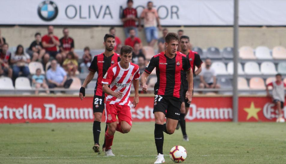 El roig-i-negre, Alfred Planas, durant un partit.