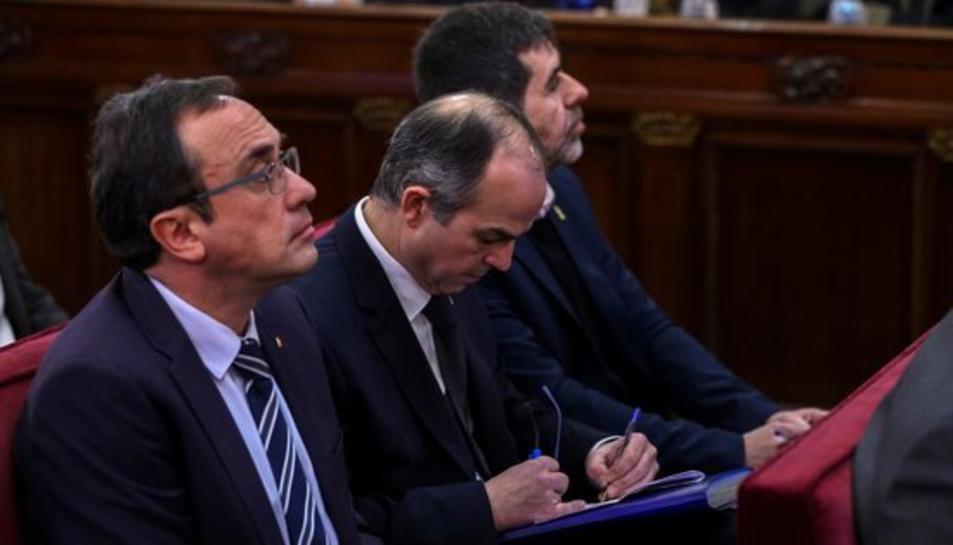 Josep Rull, Jordi Turull i Jordi Sànchez, durant la primera jornada del judici de l'1-O.
