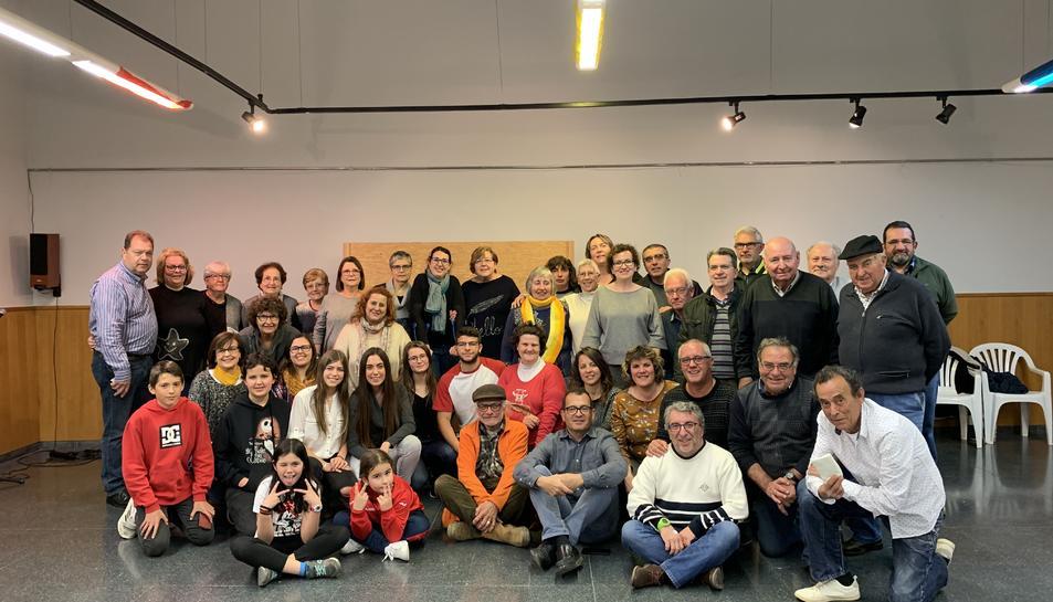 Fotografia de família dels voluntaris homenatjats.