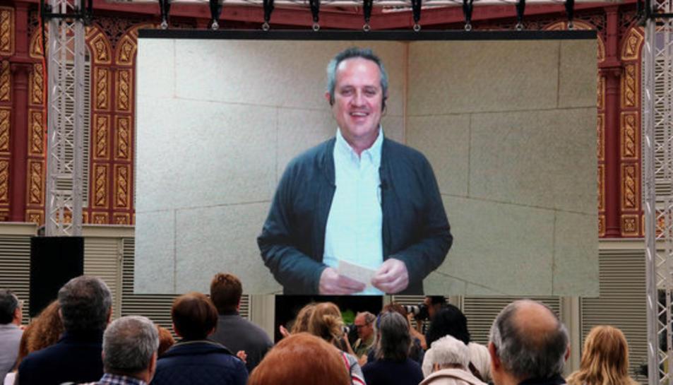 Imatge d'arxiu del cap de llista de JxCat a Barcelona, Quim Forn, durant la videoconferència des de la presó de Soto del Real al Mercat de Sant Antoni.