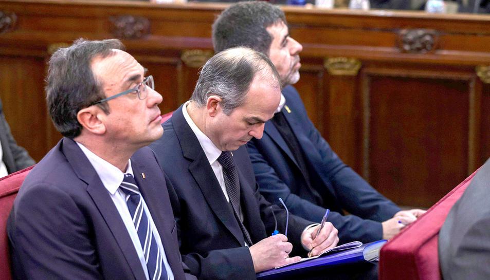 Josep Rull, Jordi Turull i Jordi Sànchez, durant la primera jornada del judici de l'1-O el 12 de febrer del 2019