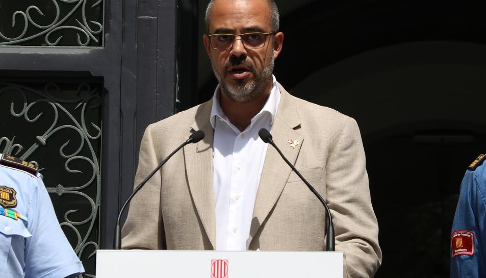 Primer pla del conseller d'Interior, Miquel Buch, durant el balanç de la revetlla.