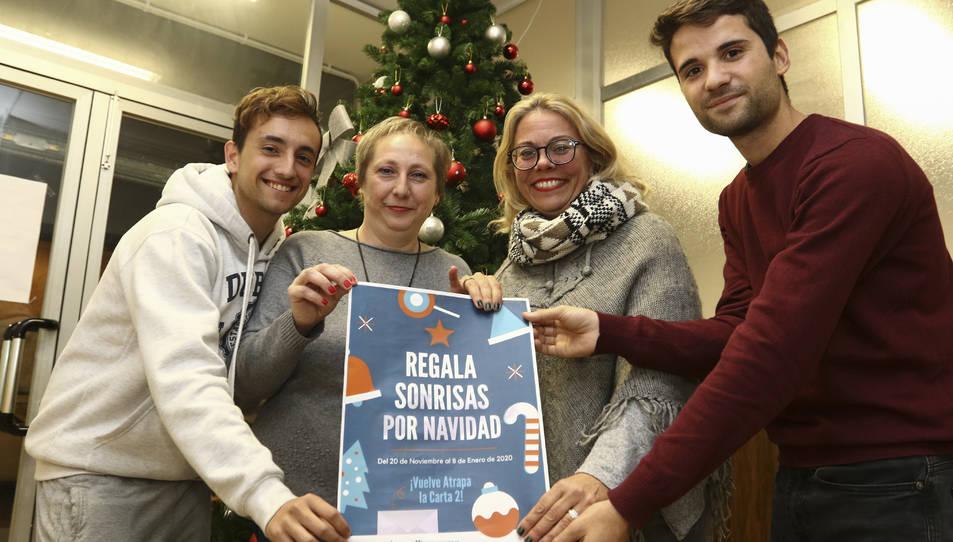 Jordi Martínez, Loli Gutiérrez, la padrina Nati Morales i Toni García, ahir a la seu de l'entitat.