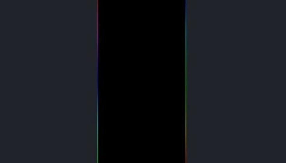 El fons de pantalla que està provocant problemes té franges de colors als marges.