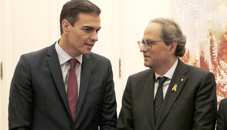 El president del govern espanyol, Pedro Sánchez, i del president de la Generalitat, Quim Torra, junts a Barcelona el 20 de desembre de 2018.
