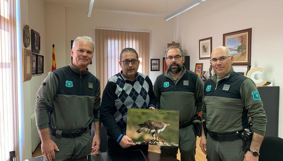 Agents Rurals amb una imatge de l'àliga cuabarrada.