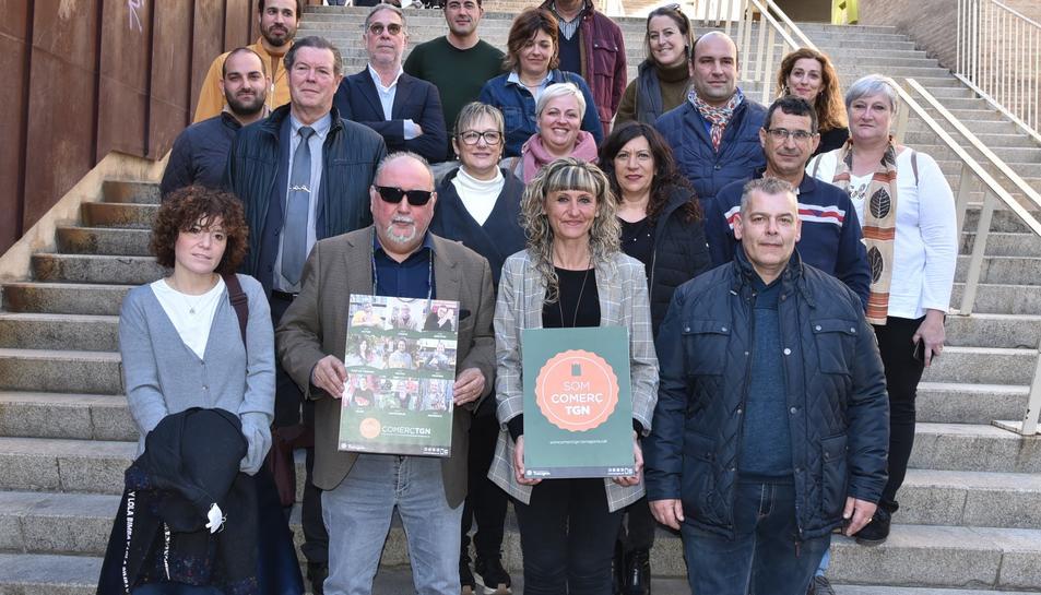Imatge posterior a la roda de premsa, amb els participants a la campanya 'Som Comerç TGN'.