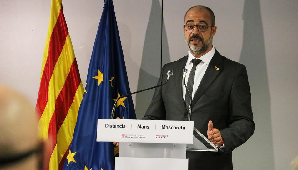 Pla mitjà del conseller d'Interior, Miquel Buch, en la roda de premsa posterior a la presentació de l'auditoria.