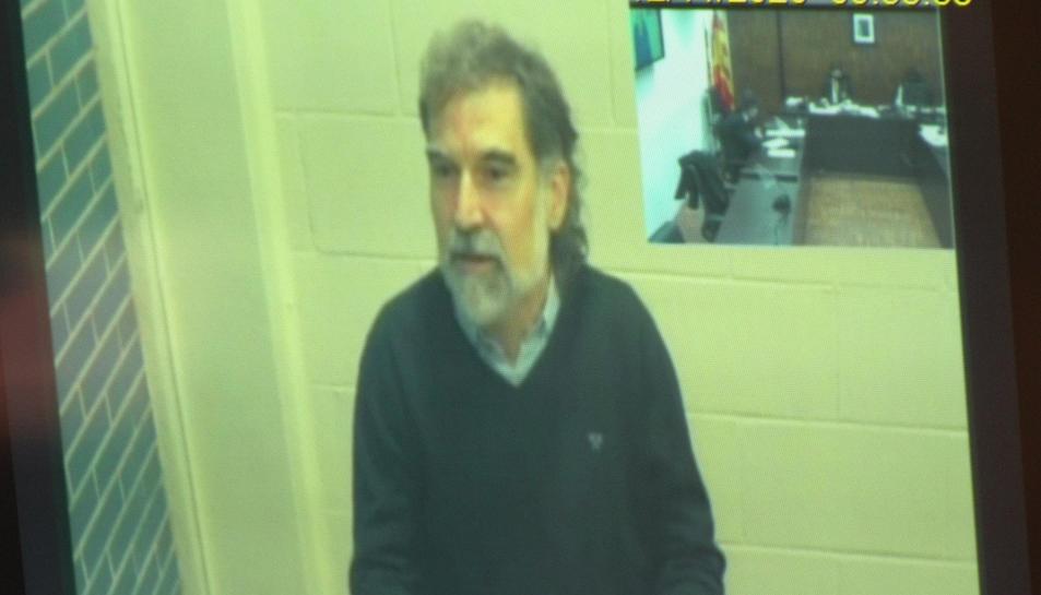 El president d'Omnium, Jordi Cuixart, durant la seva declaració, des de la presó, al judici.