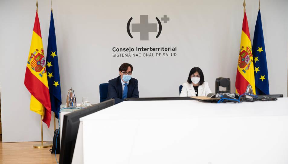 El ministre de Sanitat, Salvador Illa, i de la ministra de Política Territorial, Carolina Darias, a la reunió telemàtica del Consell Interterritorial de Salut.
