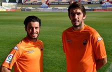 Raphael Guzzo i Dejan Lekic, amb la samarreta taronja.
