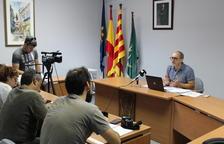 El alcalde de Bañeras del penedès explicando el acuerdo de soterramiento con la Generalitat.