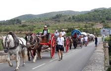 Los Portants de l'Aigua, con sus carros y caballos, pasando por el Pont d'Armentera.