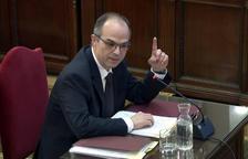 El exconseller de la Presidencia Jordi Turull alzando el dedo índice mientras responde las preguntas del fiscal.