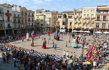 Miles de escolares participan en la fiesta Corpus en la plaza del Mercadal de Reus