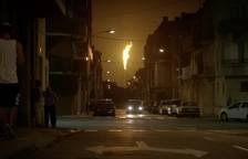 Imagen de un momento del programa donde se ve la antorcha del complejo químico de Tarragona