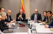 El presidente, Quim Torra, y el conseller de Interior, Miquel Buch, presiden la reunión del comité de seguimiento del episodio meteorológico.