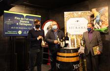 Nadal, Joan i Huguet durant la presentació de la 20a edició de la Fira al Mercat Central.